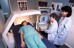 Centre AL x-ray tech school intern with radiologist and patient
